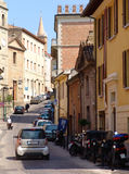 Old town street scene. Cars and motorcycles on streets of historical centre of a medieval town Stock Images