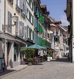 Old town street in Solothurn. Solothurn, Switzerland - 19 July, 2013: street in the historic part of the city. The city of Solothurn is the capital of the Canton royalty free stock photos