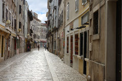 Old town street with stores in Porec in Croatia