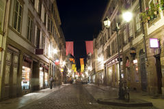 Old town street strasbourg by night. Old town street in strasbourg in france by night historical buildings and cobblestone stock images