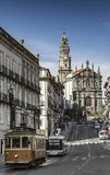 Old town street of porto portugal with tram and bus Royalty Free Stock Image