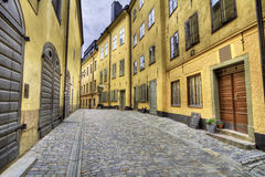 Old town street with yellow houses. Old cobblestone street with yellow houses in Stockholm Old Town stock photography