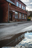 Old town streets. House in the old town streets reflecting in the puddle.  Taken at Jekabpils, Latvia Royalty Free Stock Images