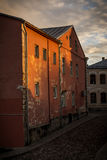 Old town at sunset. House in the old town with sun beams on it and beautiful sky at sunset. Postcard view. Great background. Taken at Jekabpils, Latvia Royalty Free Stock Photography