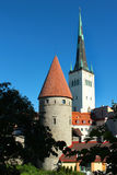 Old town of Tallinn, Estonia with bell tower of Saint Olaf church against blue sky Stock Photography