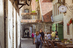Old town Tallinn, Estonia. TALLINN, ESTONIA - YUNI 14, 2015: Popular tourist street of the old town in Tallinn, Estonia Royalty Free Stock Images