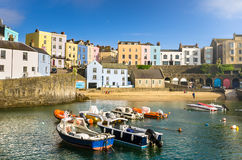Old Town Tenby and Blue Sky. Pastel Coloured Buildings alongside a Harbour in Old Town Tenby, Wales Royalty Free Stock Photo