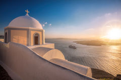 Old Town of Thira on the island Santorini, white church against colorful sunset in Greece Royalty Free Stock Photography