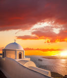 Old Town of Thira on the island Santorini, white church against colorful sunset in Greece Stock Image