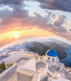 Old Town of Thira on the island Santorini, white church against colorful sunset in Greece Royalty Free Stock Photos