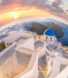 Old Town of Thira on the island Santorini, white church against colorful sunset in Greece Royalty Free Stock Image