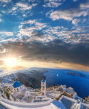 Old Town of Thira on the island Santorini, white church against colorful sunset in Greece Royalty Free Stock Images