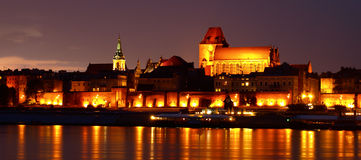 Old town of Torun at night. A night-time panorama of the old town of Torun in Poland Stock Photos