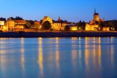 Old town of Torun at night reflected in Vistula river royalty free stock images
