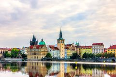 Old Town Tower and the famous walking bridge in Prague, view fro. M the Vltava royalty free stock photos