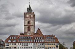 Old town townhouses and Gothic church tower Royalty Free Stock Image