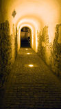 Old town tunnel. Illuminated tunnel in Hermanstadt (Sibiu), Romania Royalty Free Stock Images