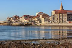 Old town in Umag, Istria, Croatia on Adriatic coast. Old town in Umag, Istria, Croatia with reflection in the sea on a sunny day royalty free stock images