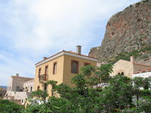 Old Town Under the Cliff. A part of an old town under a steep cliff, Monemvasia, Greece royalty free stock image