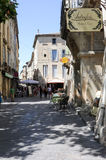 The old town of Uzes on France. Uzes, France - 26 June 2012: People walking at the old town of Uzes on France Royalty Free Stock Photography