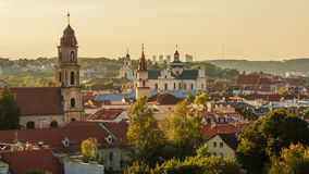 Old Town of Vilnius, Lithuania. Towers of medieval churches. Stock Photos