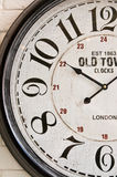 Old town wall clock face. A classic clock face on white wall royalty free stock images