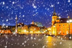 Old town of Warsaw on a cold winter night with falling snow. Poland stock image