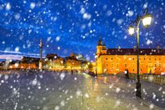 Old town of Warsaw on a cold winter night with falling snow. Poland royalty free stock photo