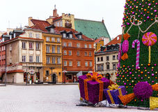 Old town of Warsaw with medieval houses, christmas tree, gifts. Famous castle square of Warsaw with colorful medieval houses, christmas tree and gifts. Old town royalty free stock image