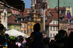 Old town of Warsaw, people wearing colorful clothes stock photo