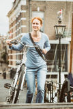 Old Town - Woman with a Bicycle Royalty Free Stock Photography