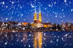 Old town of Wroclaw on a cold winter night with falling snow. Poland stock photo