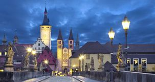 Old town of Wurzburg, Germany at dusk. View from Old Main Bridge static image with animated sky stock footage