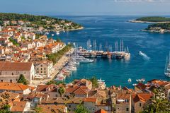 The old town and yacht harbor of the popular tourist resort island of Hvar, Croatia. stock images