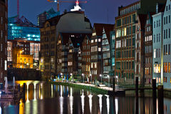 Old townhouses at the canal in Hamburg by night Stock Photography