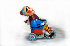 Old toy. Old metal toy: child on a bike Royalty Free Stock Photography