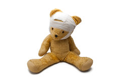 An Old Toy. Bear With Sticking Bandage Isolated On White Background Stock Image