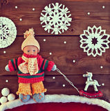 Old toy boy in knitted warm clothes Stock Images