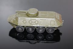 An old toy for boys - an armored personnel carrier. Model military equipment. BTR. Armored car stock photo