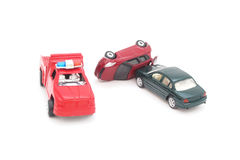 Old toy car in accident and police truck Stock Image