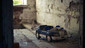 The old toy car. In a room in an abandoned house on the floor Royalty Free Stock Image