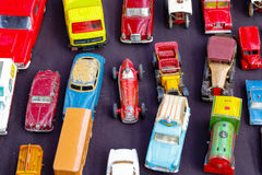 Old toy cars displayed at a junk shop. In Old Spitalfields Market in London royalty free stock image