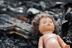 Old toy doll in the midst of ruins and devastation.  Royalty Free Stock Image
