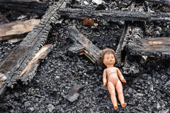 Old toy doll in the midst of ruins and devastation.  Royalty Free Stock Photography