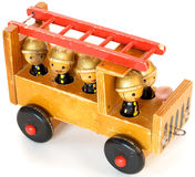 Old toy fire-engine. Ancient wooden toy fire-engine on a white background stock photography