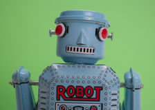 Old toy robot. Closeup green background Stock Image