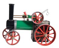 Old Toy Steam Engine. In the shape of a threshing tractor.l Royalty Free Stock Photo