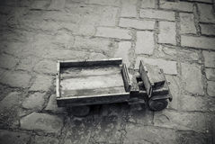 An old toy truck. A wooden toy truck on the ground Stock Photography