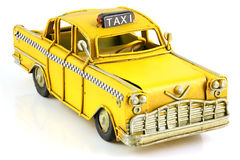 Old toy yellow taxi Royalty Free Stock Image