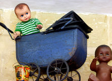 Old toys. Carriage, dolls, bucket Stock Photography